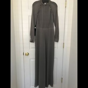 Stunning Bebe  jumpsuit lined, new, size 8